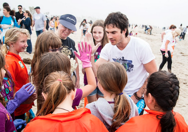 Ian Somerhalder and volunteer school kids clean up California's beaches.