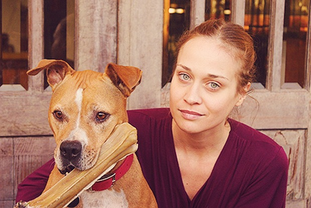 Fiona Apple postponed her music tour to stay home with her dying pit bull, Janet.
