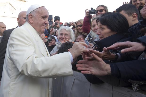 Pope Francis greets pilgrims.